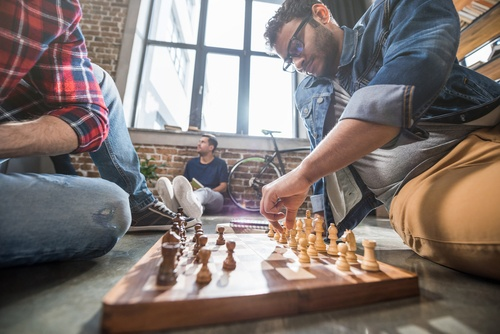 Employees playing chess in an office environment