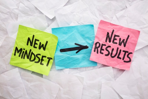 Sticky notes with writing that say new mindset goes to new results
