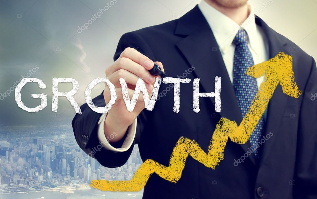 Businessman writing Growth